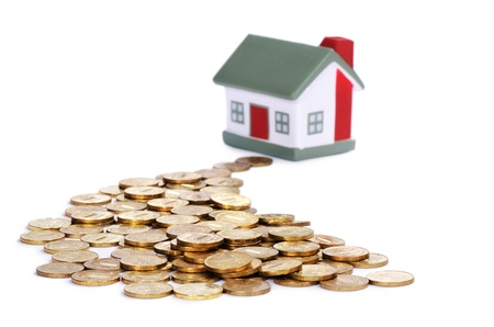 Toy small house and coins . concept Stock Photo