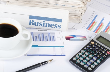 financial newspaper: Coffee and the fresh newspaper - morning of the businessman