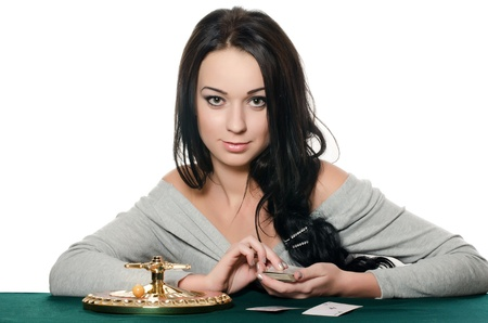 The beautiful girl with a playing card photo