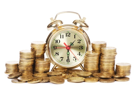 Alarm clock and money isolated on white