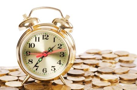 Alarm clock and money isolated on white Stock Photo - 12889635