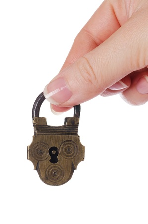 old key: The lock in hand isolated on white