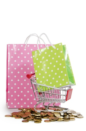 Shopping cart and bags isolated on white photo
