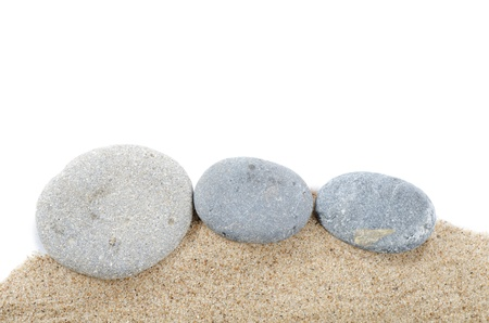 rock garden: The stones on sand isolated on white