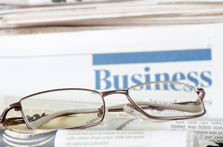 Business the newspaper with chart Stock Photo - 12889711