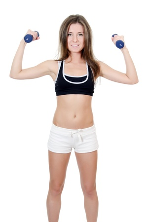 The girl does exercises with dumbbells isolated Stock Photo - 13064375