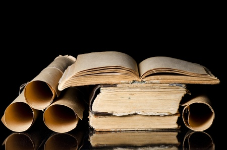 Many ancient scrolls and books on black