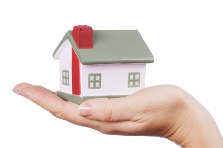 The model house in female hands isolated Stock Photo - 12984819