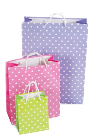 Bright gift bags isolated on white background photo