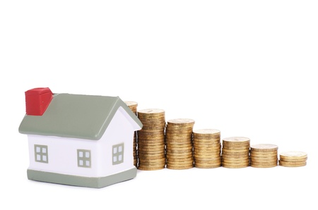 Toy house and coins in the form of the diagram Stock Photo - 12984727