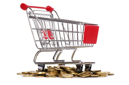 Shopping cart and coins isolated on white photo