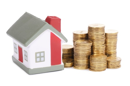 property development: Toy house and coins in the form of the diagram