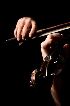 fiddlestick: Female hands play a violin on black