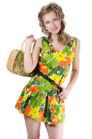 The beautiful girl in summer dress isolated photo
