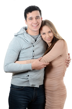Beautiful young pair on the white background photo