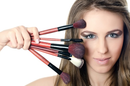 The beautiful girl with brushes for make-up photo