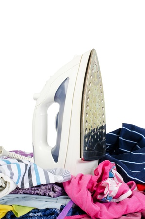 Heap of pure clothes with an iron Stock Photo - 13079228