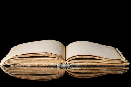 open bible: The old books on a black background Stock Photo