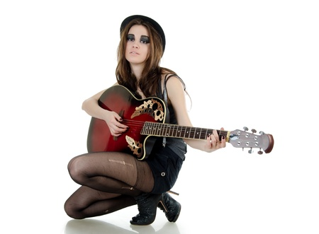 Girl with a guitar - grunge style photo