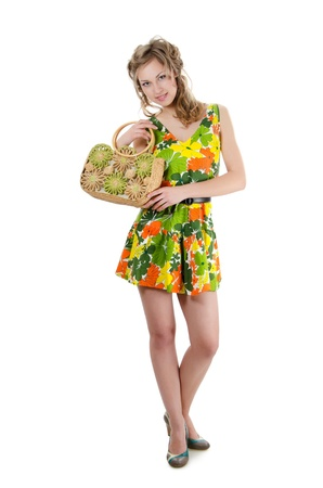 The beautiful girl in summer dress isolated Stock Photo - 13077523