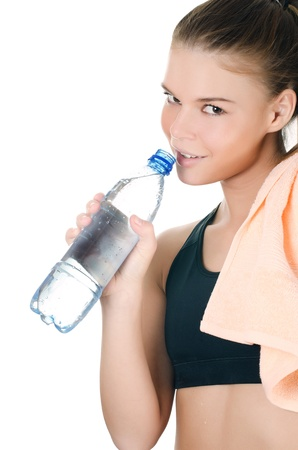 Sports girl with towel and water bottle photo