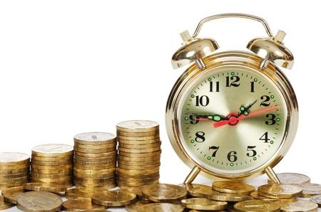 Alarm clock and money isolated on white Stock Photo - 13287810