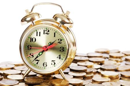 Alarm clock and money isolated on white Stock Photo - 13287811