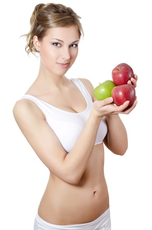 The beautiful girl with fresh apples isolated photo