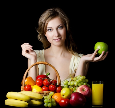 family health: The beautiful girl with fruit and vegetables Stock Photo
