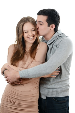 sexy kiss: Beautiful young pair on the white background Stock Photo