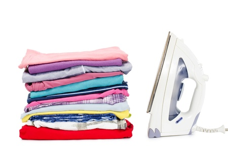 Heap of pure clothes with an iron photo