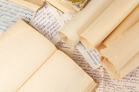 credence: Many ancient scrolls on old letters -retro Stock Photo