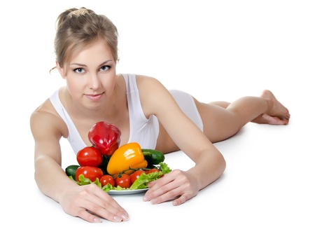 The beautiful girl with fruit and vegetables Stock Photo - 13632851