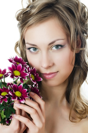 The girl with beautiful hair with chrysanthemum photo
