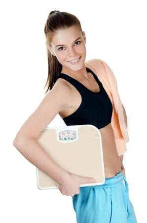 La jeune fille sportive avec des échelles isolé sur blanc