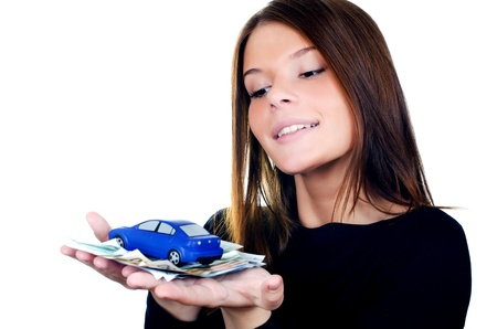 The beautiful woman with money and toy car in hands photo
