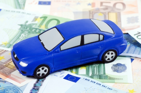 pricey: Toy car for euro banknotes  as background Stock Photo