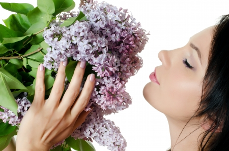 Beautiful woman with flowers of lilac. Skincare Stock Photo - 13756591