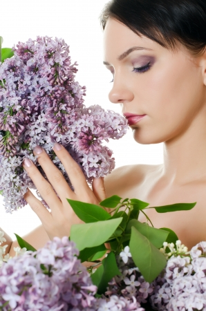Beautiful woman with flowers of lilac. Skincare Stock Photo - 13756621