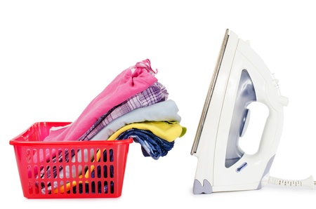 Heap of pure clothes with an iron Stock Photo - 13907278