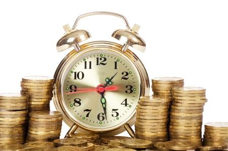 Alarm clock and money isolated on white photo