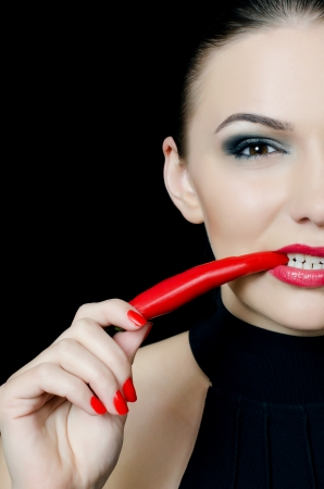 The beautiful girl with red pepper chili Stock Photo - 13905676