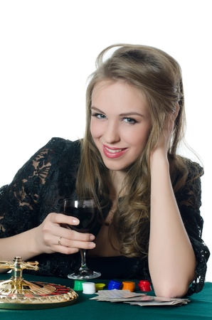 The beautiful girl with a wine glass photo