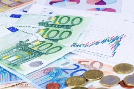 Banknotes of euro with chart a background photo