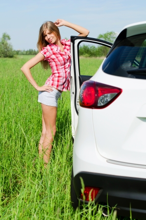Beautiful girl stands near to white car Stock Photo - 13975283