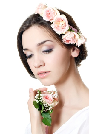 Portrait of girl with flowers in hair photo