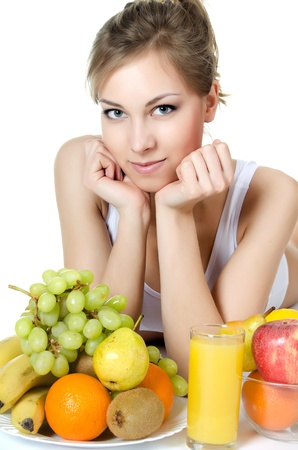 The beautiful girl with fruit and vegetables photo