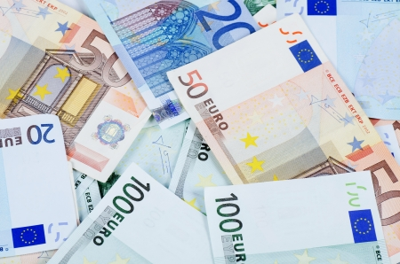 scattered: New euro banknotes as a background, close-up