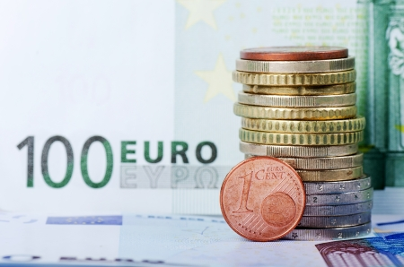 currency exchange: Various scattered Euro currency bills and coins Stock Photo