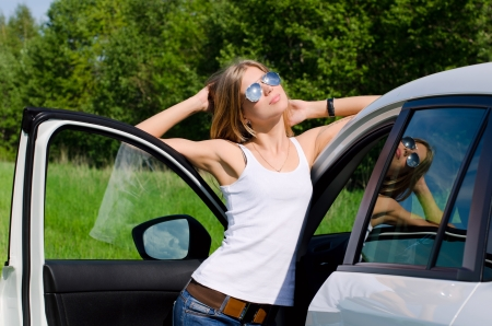 Beautiful girl stands near to white car Stock Photo - 14047960